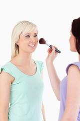 Charming Women applying make-up