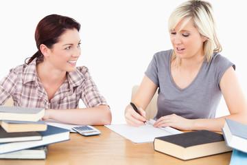 Student explaining homework to friend