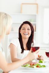 Portrait of laughing Women drinking wine