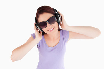 Red-haired Woman with headphones and sunglasses