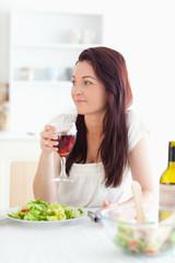 Close up of a beautiful women drinking wine
