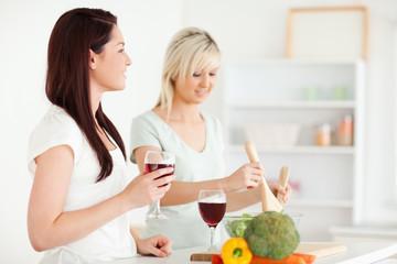 Happy Women cooking dinner