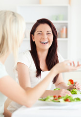 Portrait of cheerful Women eating salad