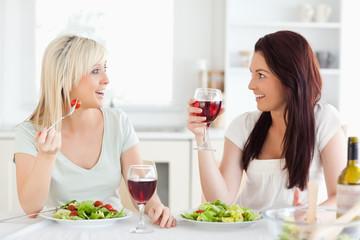 Charming women drinking wine