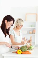 Smiling Women preparing dinner