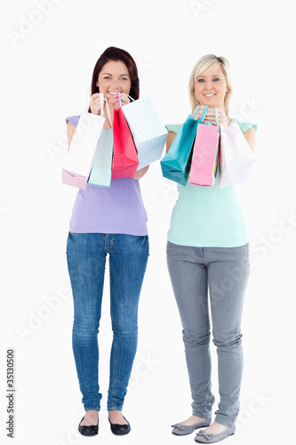 Charming women with shopping bags