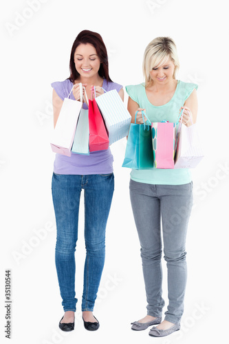 Cute women with shopping bags