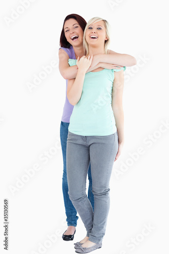 Laughing Women hugging