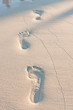 Footprints on the beach left behind