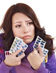 Girl having flu taking pills