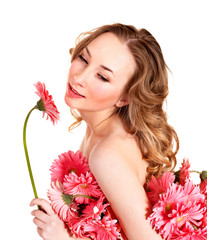 Young woman holding flower.
