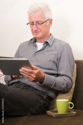 Senior working on a tablet pc