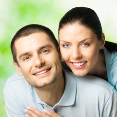 Portrait of young happy couple, outdoors