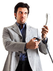 Portrait of a stressed businessman cutting a telephone cable
