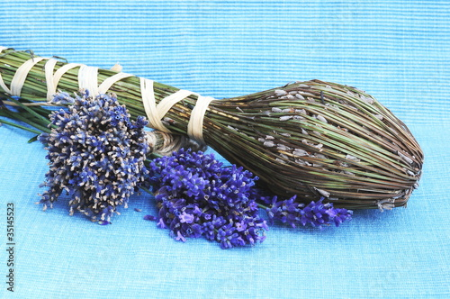 dried lavender flowers on a blue background
