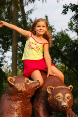 The little girl on a brown bear