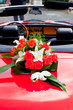 Flower's bouquet on a red car