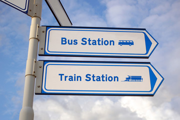 bus station and train station signs