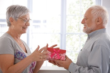 Senior female getting present from husband