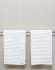 White towels on a bathroom rail