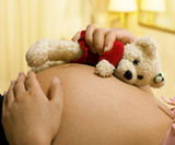 Expectant Mother Holding a Teddy Bear