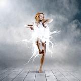 Jump of ballerina with dress of milk