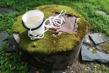 typical concrete water well with moss