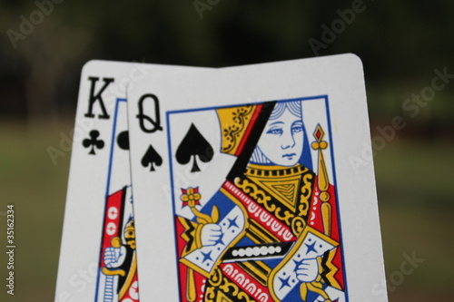 The king and the queen cards outdoor with green background