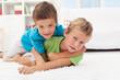 Kids wrestling on the floor - boys game