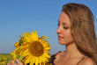Young beautiful girl with a bouquet of sunflowers