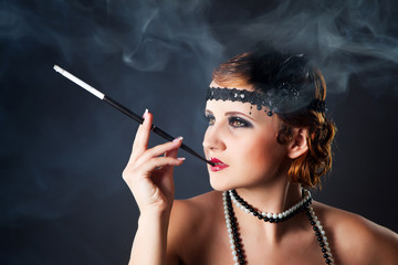 Smoking retro-styled sexy lady