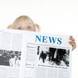Leinwanddruck Bild - Cute blond child is reading newspaper