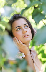 thoughtful cute girl in nature