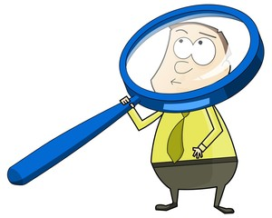 businessman looking through a big magnifying glass