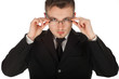 serious businessman in black suit correcting glasses