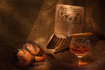 Still-life with cigar and cognac Glass of cognac and cigar