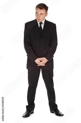 standing serious businessman in black suit, full length