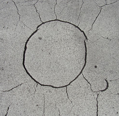 odd circular sun shape crack in white grunge surface