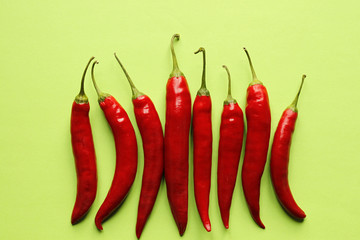 Red chili peppers on a green background