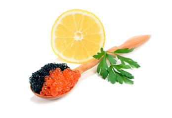 caviar black and red is in a wooden spoon