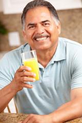 Senior man drinking orange juice