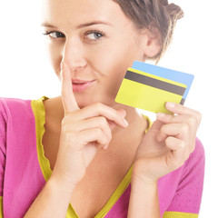 Beautiful young woman looks down at colorful credit cards in her