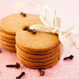 Heart shaped gingerbread cookies and cloves