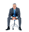 Relaxed male business executive sitting on a chair