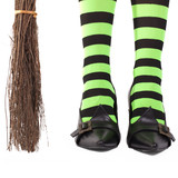 Witch's stripy legs and broomstick.
