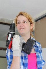 Squint girl with drill