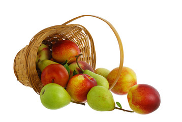 Fresh fruits spilled from interwoven basket