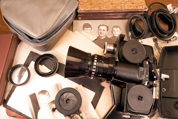 Vintage video camera, accessories and old photo.