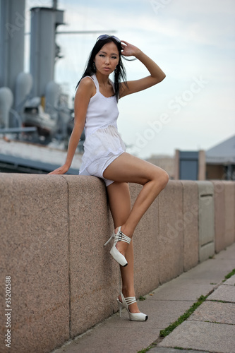 Asian woman near wall