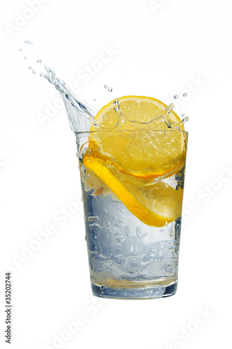 Foto op Canvas Opspattend water Lemon and water